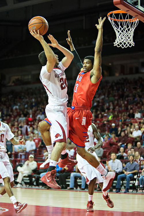FAYETTEVILLE, AR - NOVEMBER 18:  Kikko Haydar #20 of the Arkansas Razorbacks goes up for a shot over Crandall Head #13 of the SMU Mustangs at Bud Walton Arena on November 18, 2013 in Fayetteville, Arkansas.  The Razorbacks defeated the Mustangs 89-78.  (Photo by Wesley Hitt/Getty Images) *** Local Caption *** Kikko Haydar; Crandall Head