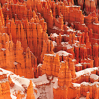 Red Rock formations illuminated by light reflected off the snow near Inspiration Point in Bryce Canyon Utah.