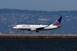 Boeing 737-824 (N24211) operated by United Airlines landing at San Francisco International Airport (KSFO), San Francisco, California, United States of America
