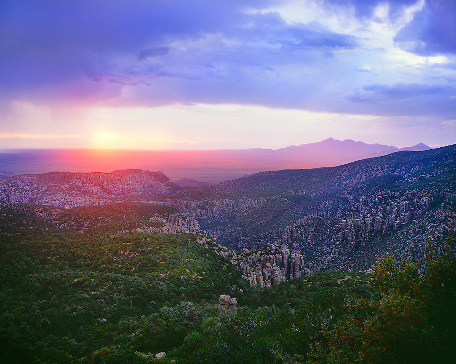 0103-1021 ~ Copyright:  George H. H. Huey ~ Sunset, seen from the Sugarloaf Lookout Trail.  Chiricahua National Monument, Arizona.