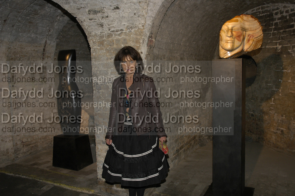 Emily Young with her work, Emily Young, Recent Stone carvings, St. Pancras church crypt. 15 September 2004. SUPPLIED FOR ONE-TIME USE ONLY-DO NOT ARCHIVE. © Copyright Photograph by Dafydd Jones 66 Stockwell Park Rd. London SW9 0DA Tel 020 7733 0108 www.dafjones.com