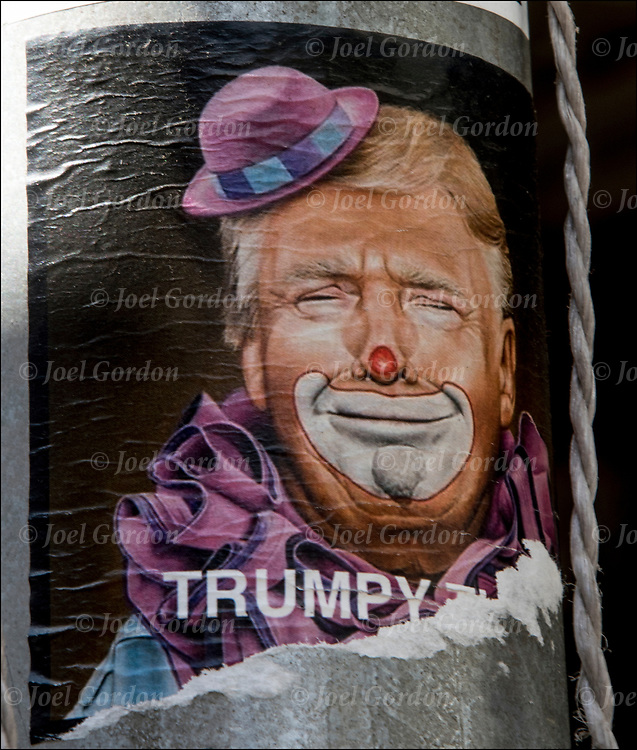 &quot;Trumpy&quot;  Sticker Street Art on side of scaffolding pole of Prsident Trump as clown.<br /> <br /> Graffiti street art on side of street poll base in Manhattan.<br /> <br /> Sticker art (also known as sticker bombing, sticker slapping, slap tagging, and sticker tagging) is a form of street art in which an image or message is publicly displayed using stickers. <br /> <br /> These stickers may promote a political agenda, comment on a policy or issue, or comprise a subcategory of graffiti.<br /> <br /> Sticker artists use a variety of label types, including inexpensively purchased and free stickers, such as the United States Postal Service's Label 228 or name tag.