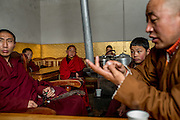 Buddhist monks in their monastery overlooking Zado, Tibet (Qinghai, China).