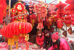 Chinese new year goods market in Kaifeng, central China's Henan Province, Jan. 30, 2013. As the spring festival drew near, began their shopping for the celebration., January 29, 2013. Photo by Imago / i-Images..UK ONLY