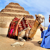 Camel and Egyptian Man at Step Pyramid in Cairo, Egypt<br />