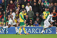 Jonny Howson of Norwich looks dejected as Jose Salomon Rondon of West Bromwich Albion celebrates scoring his sides 1st goal during the Barclays Premier League match at Carrow Road, Norwich<br /> Picture by Paul Chesterton/Focus Images Ltd +44 7904 640267<br /> 24/10/2015