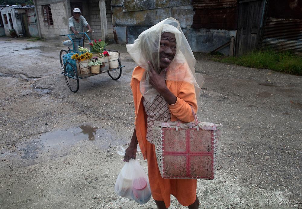 Cuban People Walk Through A Settlement El Fanguito Where