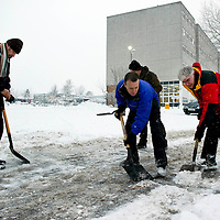 More Heavy Snow Across Perth as Children Go Back To School....06.12.10<br /> Head teacher Mr Jim Scott (red jacket) along with fellow teachers Dave Millar, Rob Hands and Graeme Dewar clearing the snow from Perth High School trying to get back to normal as heavy snow continues to fall<br /> Picture by Graeme Hart.<br /> Copyright Perthshire Picture Agency<br /> Tel: 01738 623350  Mobile: 07990 594431