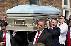 © Licensed to London News Pictures. 21/04/2018. Cobham, UK. Paddy Doherty (2R) carries the coffin of his mother Queenie, Elizabeth Doherty at Sacred Heart Church in Cobham, Surrey. Elizabeth Doherty, whose son Paddy Doherty is known for appearing on My Big Fat Gypsy Wedding and winning Celebrity Big Brother 8, died of a heart attack earlier this month. Paddy Doherty claimed his mother has died of a 'broken heart' following the death of her husband almost a year ago. Photo credit: Peter Macdiarmid/LNP