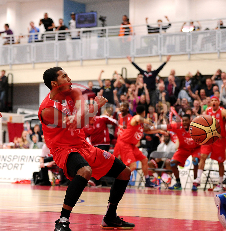 Bristol Flyers' Dwayne Lautier-Ogunleye celebrates his slam dunk along with his team mates and the Flyers fans   - Photo mandatory by-line: Joe Meredith/JMP - Mobile: 07966 386802 - 11/04/2015 - SPORT - Basketball - Bristol - SGS Wise Campus - Bristol Flyers v Glasgow Rocks - British Basketball League