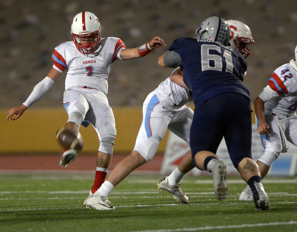 gbs102016s/SPORTS -- Sandia quarterback Jacob Archibeque, 1, punts during the game against La Cueva at Wilson Stadium on Thursday, October 20, 2016.(Greg Sorber/Albuquerque Journal)