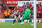 Brentford Defender Jake Bidwell has an attempt at goal  during the Sky Bet Championship match between Brentford and Sheffield Wednesday at Griffin Park, London, England on 26 September 2015. Photo by Phil Duncan.