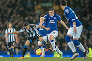Ayoze Perez (Newcastle United) and Gareth Barry (Everton) fight for the ball during the Barclays Premier League match between Everton and Newcastle United at Goodison Park, Liverpool, England on 3 February 2016. Photo by Mark P Doherty.