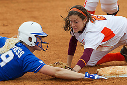 UK first baseman Lauren Cumbess, left, slides safely into second base after Virginia Tech shortstop Bkaye Smith missed the tag at second, Saturday, May 18, 2013 at John Cropp Stadium in Lexington. Photo by Jonathan Palmer..The University of Kentucky Softball team hosted Virginia Tech in KY Regional Game 3 of the NCAA D1 Softball Championship.