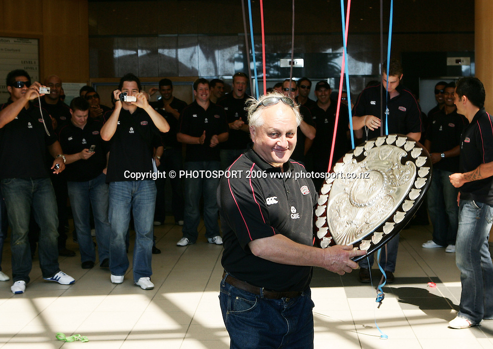 North Harbour trainer Spy Kelly holds up the Ranfurly Shield as members of the North Harbour squad take photos before the street parade for the North Habour Air NZ Cup team who won the Ranfurly Shield last weekend, at Takapuna, Auckland, on Thursday 28 September 2006. Photo: Tim Hales/PHOTOSPORT