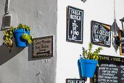 Signs, restaurant, Spain; Arcos de la Frontera