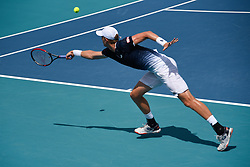 March 25, 2019 - Miami Gardens, FL, U.S. - MIAMI GARDENS, FL - MARCH 25:  Kevin Anderson from South Africa reaches with a backhand in his third round match at the Miami Open on March 25, 2019 at Hard Rock Stadium in Miami Gardens, FL(Photo by Michele Sandberg/Icon Sportswire) (Credit Image: © Michele Sandberg/Icon SMI via ZUMA Press)