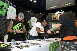 October 7, 2011; Houston, TX.; USA;  Clay Guida and Rashad Evans sign autographs for fans at the UFC 136 Fan Expo at the George R. Brown Convention Center in Houston, TX.