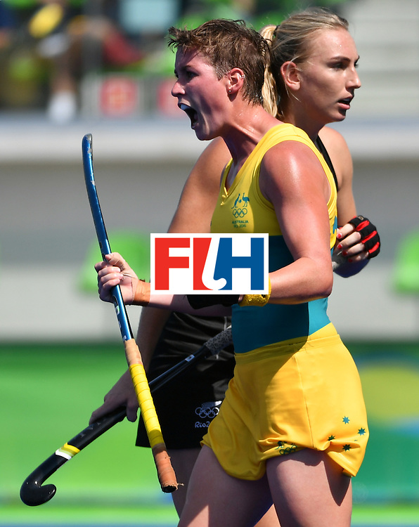 Australia's Kathryn Slattery (L) celebrates a goal during the the women's quarterfinal field hockey New Zealand vs Australia match of the Rio 2016 Olympics Games at the Olympic Hockey Centre in Rio de Janeiro on August 15, 2016. / AFP / Pascal GUYOT        (Photo credit should read PASCAL GUYOT/AFP/Getty Images)