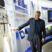 Jonathan Clark examines the items on display at the Red Bull Stratos Exhibit, at The Smithsonian National Air and Space Museum in Washington, D.C., USA on 1 April, 2014.