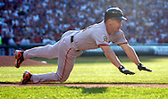 Omar Vizquel dives into first base while grounding out in his first at bat against Cleveland.