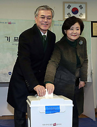 Moon Jae-in, South Korean presidential candidate of the center-left main opposition Democratic United Party, prepares to cast his ballot with his wife at a polling station in Pusan, December 19, 2012, Photo by Imago / i-Images...UK ONLY