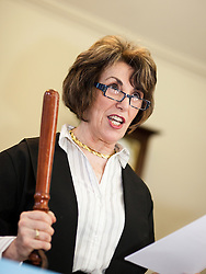 © Licensed to London News Pictures . 15/11/2012 . Manchester , UK . Former Minister EDWINA CURRIE waves a police baton as she plays a court clerk in a mock trial at a Jail and Bail fundraising event for the British Red Cross . The event , which took place at the Manchester Police Museum , sees high profile lawyers answering mock charges before being taken to the cells and having to raise £999 bail (donated to the Red Cross) to secure their release . Photo credit : Joel Goodman/LNP