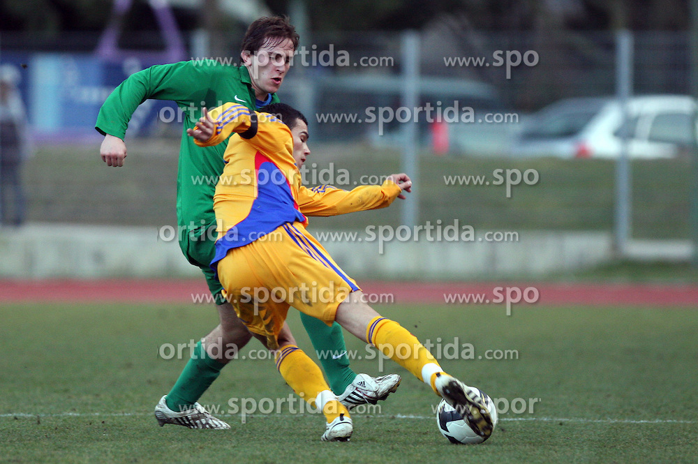 Nikola Tolimir (6)  of Slovenia vs Catalin Iorga of Romania  during Friendly match between U-21 National teams of Slovenia and Romania, on February 11, 2009, in Nova Gorica, Slovenia. (Photo by Vid Ponikvar / Sportida)