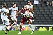 Ipswich Town striker James Norwood (10) battles for possession  with Milton Keynes Dons defender Russell Martin (16) during the EFL Sky Bet League 1 match between Milton Keynes Dons and Ipswich Town at stadium:mk, Milton Keynes, England on 17 September 2019.