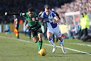 Bristol Rovers Lee Brown (3) on the ball going past  Scunthorpe United  Duane Holmes (19)  during the EFL Sky Bet League 1 match between Bristol Rovers and Scunthorpe United at the Memorial Stadium, Bristol, England on 24 February 2018. Picture by Gary Learmonth.