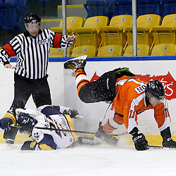 Whitby, ON - Feb 11 : Ontario Junior Hockey League game action between the Whitby Fury and the Orangeville Flyers. Whitby Fury Patrick McAuliffe #25 makes the hit on Orangeville Flyers Ryan Anton #11 during first period game action.<br /> (Photo by Tim Bates / OJHL Images)