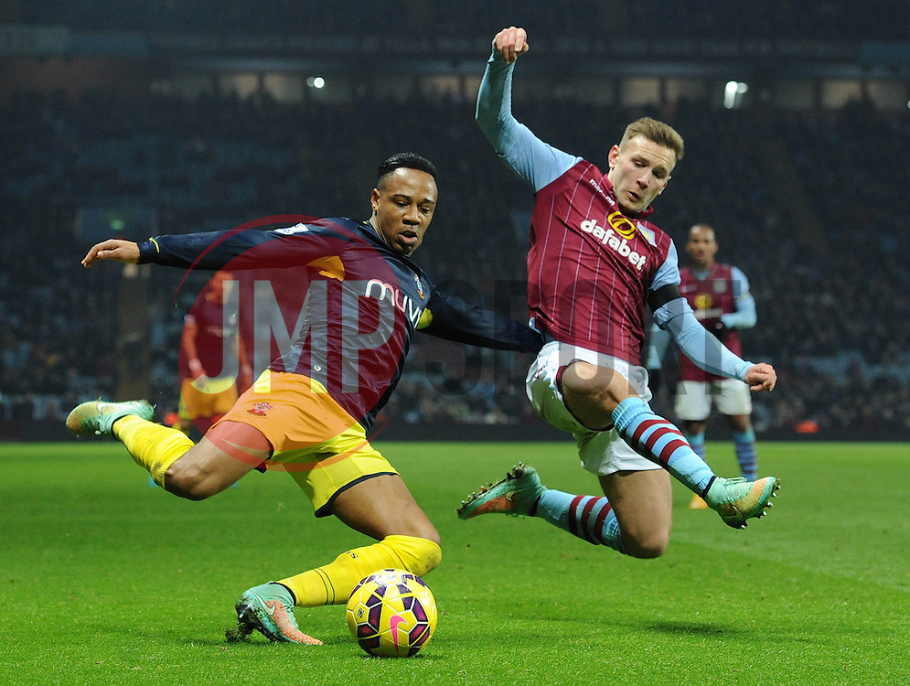 Southampton's Nathaniel Clyne is challenged by Aston Villa's Andreas Weimann - Photo mandatory by-line: Dougie Allward/JMP - Mobile: 07966 386802 - 24/11/2014 - SPORT - Football - Birmingham - Villa Park - Aston Villa v Southampton - Barclays Premier League