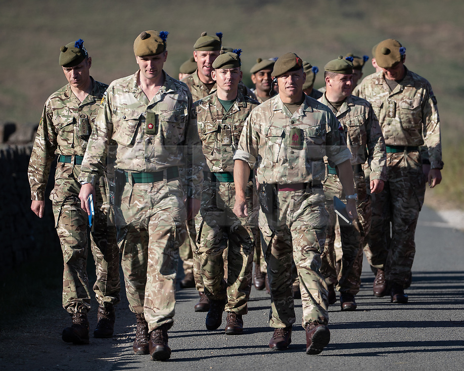 """© Licensed to London News Pictures . 28/06/2018 . Saddleworth , UK . Soldiers arrive at Higher Swineshaw Reservoir . The army are being called in to support fire-fighters , who continue to work to contain large wildfires spreading across Saddleworth Moor and affecting people across Manchester and surrounding towns . Very high temperatures , winds and dry peat are hampering efforts to contain the fire , described as """" unprecedented """" by police and reported to be the largest in living memory . Photo credit: Joel Goodman/LNP"""