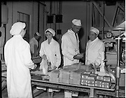 26/10/1959<br /> 10/26/1959<br /> 26 October 1959<br /> Swiss Charge d'Affairs visit to Goodbody's Factory, Dun Laoghaire, (Albright and Wilson Ireland).  Image shows the party on a tour of the factory where soda bread mix is being packaged.