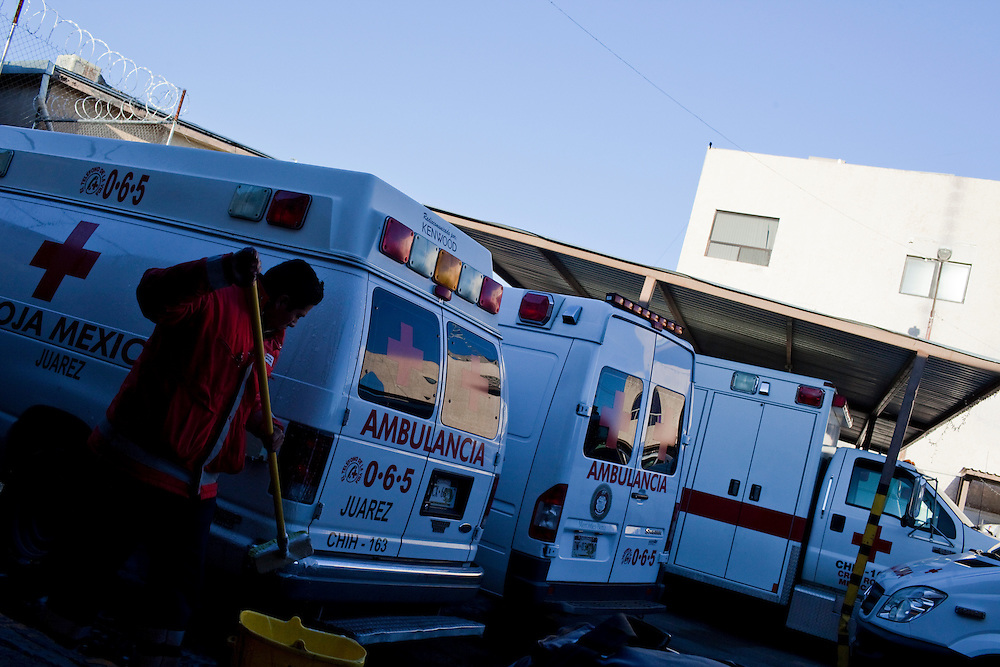 A member of the Cruz Roja Mexicana washes ambulances in Ciudad Juarez, Chihuahua Mexico on May 2, 2010.