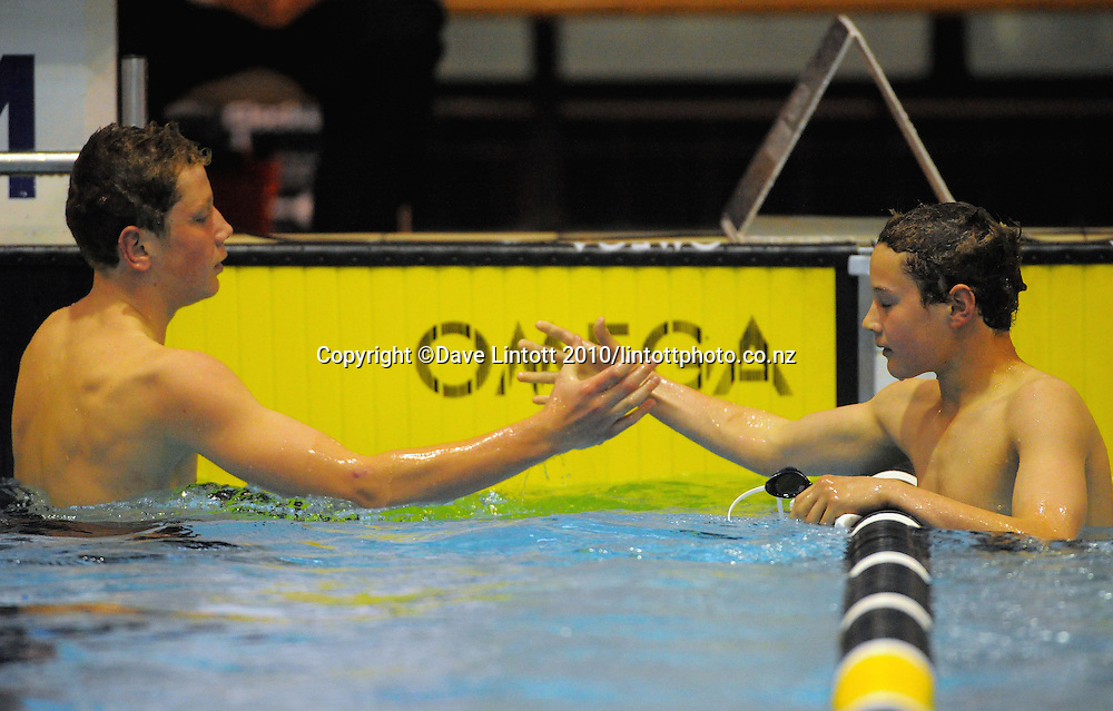 Wilrich Coetzee (right) congratulates Bayley Main on victory in the 200m 13 year old boys' medley final. New Zealand Age Group Short Course Swimming Championships at Welllington Aquatics Centre, Kilbirnie, Wellington on Sunday, 26 September 2010. Photo: Dave Lintott/photosport.co.nz