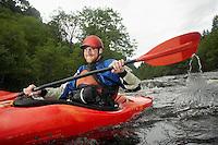 Man kayaking in river portrait