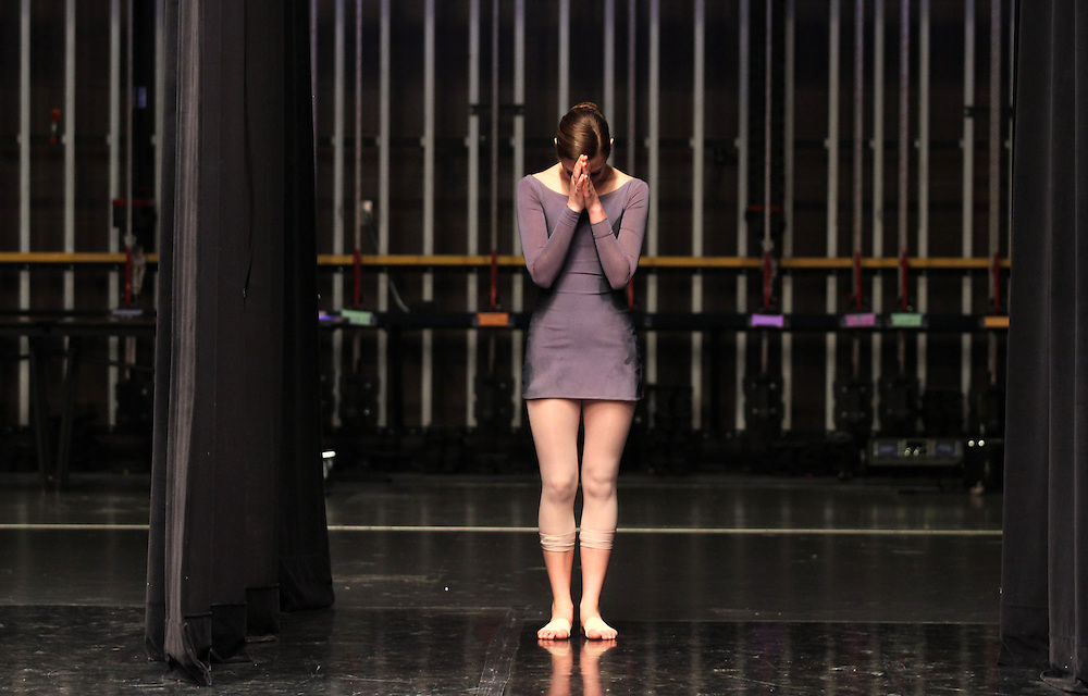 Isabella Brown, 16, prays just before performing in the Senior Contemporary Group during the The Youth American Grand Prix Semi-Regionals at Zionsville High School Saturday March 9, 2013..Photo by Chris Bergin..