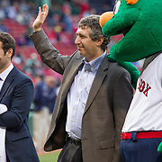 Adam Grossman, Senior Vice President of Marketing and Development for the Red Sox (L) claps for Doctor David Avigan (Middle) on the field during Fenway Park's Jewish Heritage Night at the game between the Atlanta Braves and the Boston Red Sox at Fenway Park on May 29, 2014 in Boston, Massachusetts. (Photo by Elan Kawesch/Times of Israel)