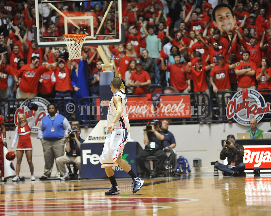 "Ole Miss' Marshall Henderson (22) gives a ""Landshark"" cheer towards the student section vs. Missouri at the C.M. ""Tad"" Smith Coliseum on Saturday, January 12, 2013. Ole Miss defeated #10 ranked Missouri 64-49."