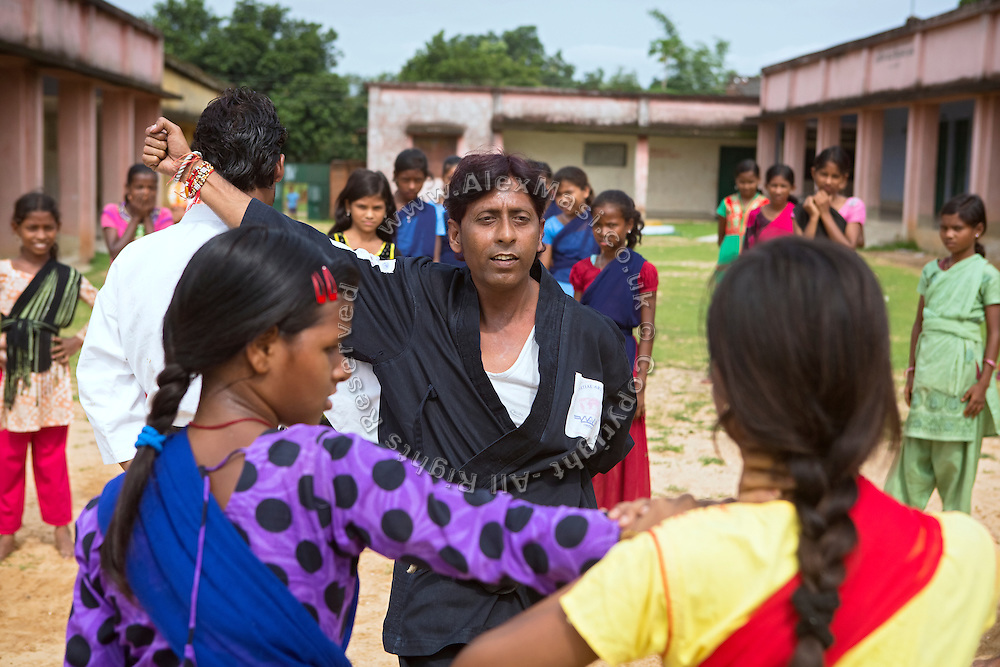 Tabasum Khatun, 14, (right) and her best friend Anju Kumari, 13, are observing a Karate counter-attack move during a class in Algunda village, pop. 1000, Giridih District, rural Jharkhand, India.
