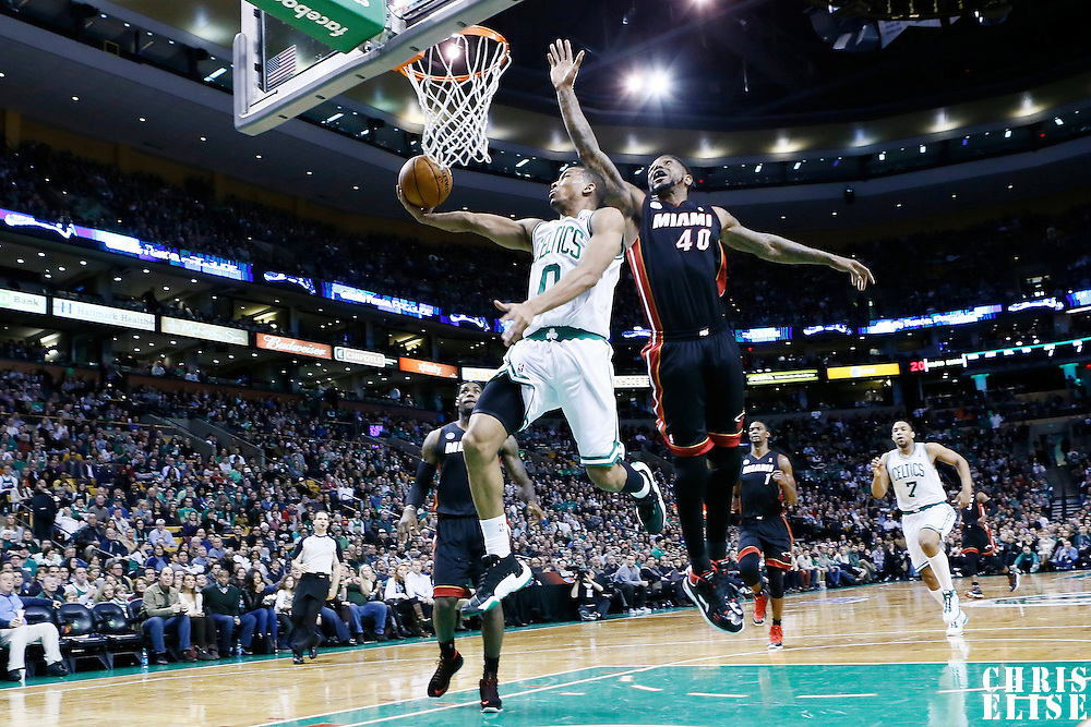 27 January 2013: Boston Celtics point guard Avery Bradley (0) goes for the reverse dunk past Miami Heat power forward Udonis Haslem (40) during the Boston Celtics 100-98  2OT victory over the Miami Heat at the TD Garden, Boston, Massachusetts, USA.