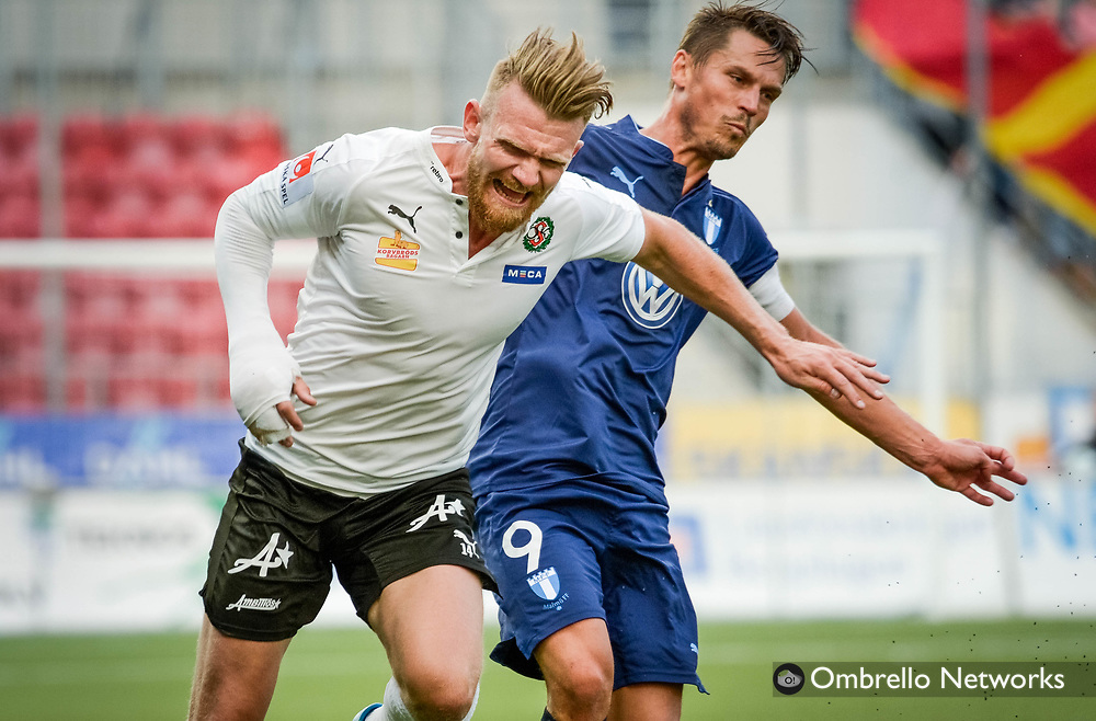 ÖREBRO, SWEDEN - AUGUST 01: Michael Almeback of Örebro SK & Markus Rosenberg of Malmö FF during the allsvenskan match between Örebro SK and Malmö FF at Behrn Arena on August 1, 2016 in Örebro, Sweden. Foto: Pavel Koubek/Ombrello