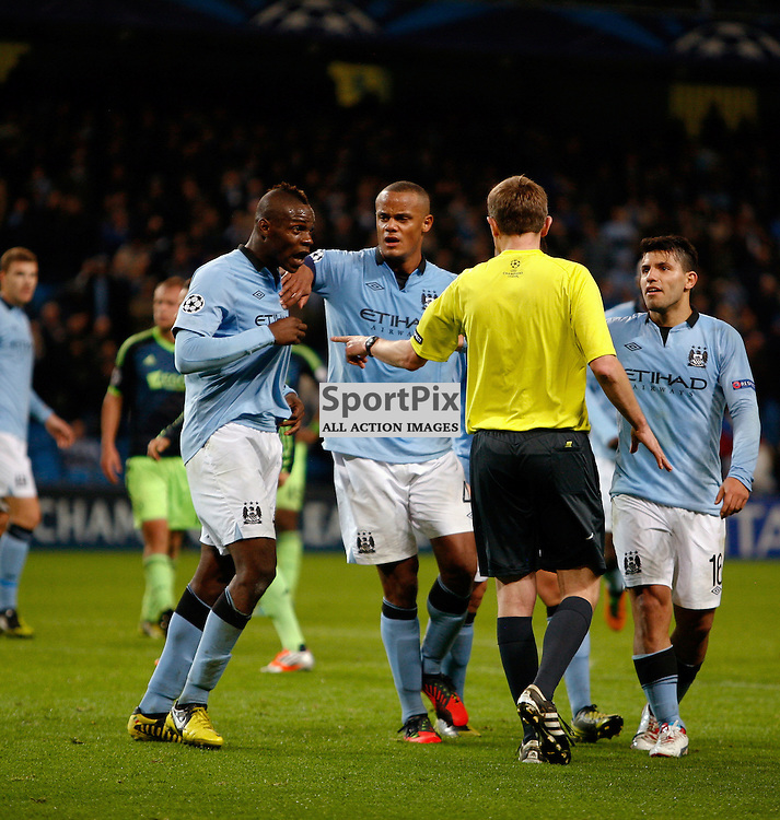 Kompany holds Balotelli as he argues with the ref about the penalty not given