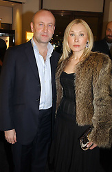 SEBASTIAN SAINSBURY and VALENTINA DROUIN at a party to celebrate the International Women's Day in association with Theo Fennell and The Russian Connection held at Theo Fennell, 169 Fulham Road, London SW3 on 1st March 2005.<br />