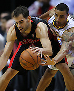 April 09, 2012; Indianapolis, IN, USA; Indiana Pacers shooting guard George Hill (3) tries to knock the ball loose from Toronto Raptors point guard Jose Calderon (8) at Bankers Life Fieldhouse. Indiana defeated Toronto 103-98. Mandatory credit: Michael Hickey-US PRESSWIRE