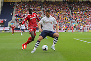 Bailey Wright holds off Albert Adomah during the Sky Bet Championship match between Preston North End and Middlesbrough at Deepdale, Preston, England on 9 August 2015. Photo by Simon Davies.