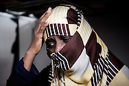 Libya, Misurata: Tecle 40 yo, an Eritrean woman who claims to have being used as sex slaves by ISIS member in Sirte is seen inside her cell at the Libyan airforce compound in Misurata. Alessio Romenzi