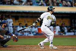 OAKLAND, CA - JULY 15:  Josh Reddick #22 of the Oakland Athletics hits a home run against the Toronto Blue Jays during the third inning at the Oakland Coliseum on July 15, 2016 in Oakland, California. (Photo by Jason O. Watson/Getty Images) *** Local Caption *** Josh Reddick