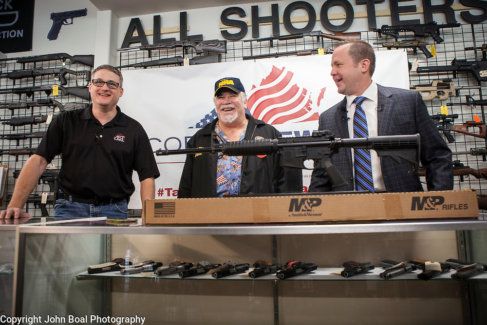 Corey Stewart, right, Chairman of the Board of Supervisors of Prince William County and Virginia Gubernatorial candidate, gave away a Smith & Wesson M&P 15 Sport II, an AR-15 rifle, to Rick Thompson, center, at All Shooters Tactical in Woodbridge, Virginia on Wednesday, January 11, 2017.  The Stewart campaign used the AR-15 giveaway as an opportuntiy to tout Stewart's record on support for the second amendment.  John Boal Photography